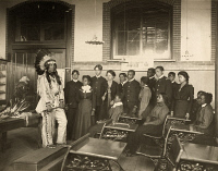 0324333 © Granger - Historical Picture ArchiveHAMPTON INSTITUTE, c1899.   Louis Firetail, a Crow Creek Sioux man, wearing tribal clothing, in an American history class at Hampton Institute, Hampton, Virginia. Photograph by Benjamin Frances Johnston, c1899.