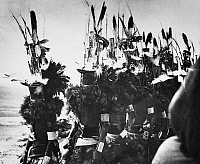 0172821 © Granger - Historical Picture ArchiveHOPI DANCERS, c1913.   Hopi dancers, wearing Hemis Kachina masks and sprigs of evergreen, lined up at a pueblo in Arizona during the Niman Kachina or 'going home' ceremony in the month of July. Photographed c1913.