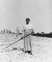 0173406 © Granger - Historical Picture ArchiveNATIVE AMERICAN FARMER.   A Native American woman tilling the soil in a field. Photograph, early 20th century.