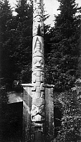0174594 © Granger - Historical Picture ArchiveCANADA: HAIDA TOTEM POLE.   Totem pole at the front of a house in the Haida village of Tanu in the Queen Charlotte Islands, British Columbia, Canada, with representations of three watchmen (top), an eagle, and a beaver (bottom). Photographed c1905.