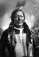0114334 © Granger - Historical Picture ArchiveDAKOTA SIOUX, c1891.   Fire Lightning, a Dakota Sioux Native American man, wearing a bone breastplate. Photographed by Charles Milton Bell, c1891.