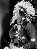 0115748 © Granger - Historical Picture ArchiveSIOUX NATIVE AMERICAN, c1900.   Joe Black Fox, a Sioux Native American from Buffalo Bill's Wild West Show. Photographed by Gertrude Käsebier, c1900.