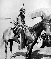 0118265 © Granger - Historical Picture ArchiveSIOUX HORSEMAN, c1901.   Willie Holy Frog, a Sioux Native American performer in Buffalo Bill's Wild West Show. Photographed c1901.