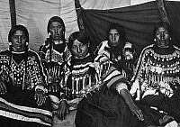 0120532 © Granger - Historical Picture ArchiveBLACKFOOT WOMEN, c1907.   Five Blackfoot women wearing clothing decorated with beads and cowrie shells. Photograph by Norman Fosyth, c1907.
