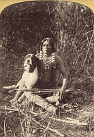 0163447 © Granger - Historical Picture ArchiveUTE MAN WITH DOG, c1874.   A young Ute man with his dog, in Utah. Photograph by John K. Hillers, c1874.