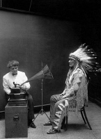 0324325 © Granger - Historical Picture ArchiveETHNOGRAPHIC RECORDING.   Mountain Chief, a Piegan Blackfoot man, having his voice recorded by ethnologist Frances Densmore. Photograph, 1916.
