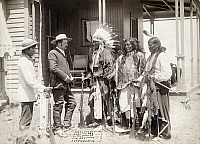0115477 © Granger - Historical Picture ArchiveCHEYENNE CHIEFS, 1887.   Cheyenne chiefs Standing Elk (in headdress), Running Hog, and Little Wolf (right) meeting with cattle rancher Harry Oelrichs and his interpreter (left) at his home in Oelrichs, South Dakota, 4 July 1887. Photographed by John C.H. Grabill.