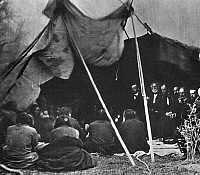 0060207 © Granger - Historical Picture ArchiveGENERAL WILLIAM T. SHERMAN   (facing camera, third from left) and other members of the presidential delegation looking on as Sioux Native American chiefs consider the terms of the peace treaty negotiated at Fort Laramie, Wyoming, in 1868.