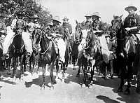 0124893 © Granger - Historical Picture ArchiveENGLAND: COWBOYS, c1900.   A group of Salvation Army London Cowboys on horseback under Major Bourne in London, England. Photograph, c1900.