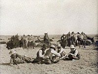 0124927 © Granger - Historical Picture ArchiveTEXAS: COWBOYS, c1906.   Several cowboys seated on the ground while playing a game of mumblety peg during a work break at the Turkey Track Ranch in Texas. Photograph by Erwin Evans Smith, c1906.