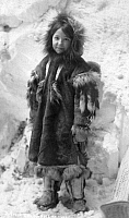 0121067 © Granger - Historical Picture ArchiveALASKA: ESKIMO GIRL.   A young Eskimo girl in traditional fur clothing, Nome, Alaska. Photograph, early 20th century.