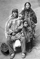 0121119 © Granger - Historical Picture ArchiveALASKA: ESKIMO FAMILY.   Eskimo father, mother and young son, Alaska. Photograph,early 20th century.