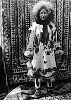 0121174 © Granger - Historical Picture ArchiveALASKA: ESKIMO WOMAN.   Eskimo woman wearing clothing made of fur, Alaska. Photograph, early 20th century.