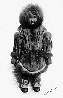 0121181 © Granger - Historical Picture ArchiveALASKA: ESKIMO CHILD.   Eskimo child dressed in traditional fur clothing, Nome, Alaska. Photographed by the Lomen Brothers, early 20th century.