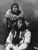 0121189 © Granger - Historical Picture ArchiveALASKA: ESKIMOS, c1903.   Two Eskimo women in traditional fur clothing, Nome, Alaska. Photographed by the Lomen Brothers, c1903.