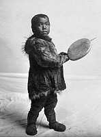 0121196 © Granger - Historical Picture ArchiveESKIMO CHILD, c1905.   Eskimo child wearing traditional fur clothing in Nome, Alaska. Photographed by the Lomen Brothers, c1905.
