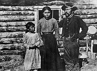 0121415 © Granger - Historical Picture ArchiveALASKA: ESKIMO FAMILY.   Eskimo couple in Alaska with their daughter. Photograph, early 20th century.