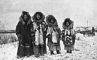 0121416 © Granger - Historical Picture ArchiveALASKA: ESKIMO WOMEN.   A group of four Eskimo women standing outside, dressed in their traditional fur clothing. Photograph, early 20th century.