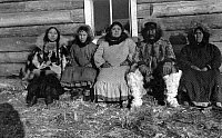 0121417 © Granger - Historical Picture ArchiveALASKA: ESKIMO FAMILY.  An woman identified as Reindeer Mary seated next to her husband, and three other women (the younger two women probably her daughters), Alaska. Photograph, early 20th cenury.