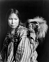 0121846 © Granger - Historical Picture ArchiveALASKA: ESKIMOS, c1912.   An Inuit woman with a child on her back, Alaska. Photograph, c1912.