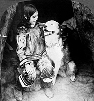 0121953 © Granger - Historical Picture ArchiveWORLD'S FAIR: ESKIMOS.   An Eskimo girl with her dog. The girl is  identified as 'Columbia,' the Eskimo child born at 1893 World's Fair in Chicago, shown here at the World's Fair, St. Louis, Missouri, U.S.A. Stereograph, c1904.