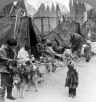 0122033 © Granger - Historical Picture ArchiveWORLD'S FAIR: ESKIMOS.   The Eskimo Village exhibit depicting the return of a group of Eskimos from a successful bear hunt, World's Fair, St. Louis, Missouri, U.S.A. Stereograph, August 1904.