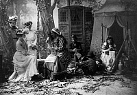 0108879 © Granger - Historical Picture ArchivePALM READING, c1902.   Staged depiction of three fashionable women having their fortunes told with cards at a Gypsy camp. Photographed c1902.