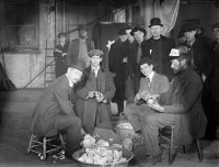 0326201 © Granger - Historical Picture ArchiveNEW YORK: HOBOS, 1915.   Hobos making mulligan stew at Hotel de Gink in New York City, a hotel for itinerant workers on the Bowery. Photograph, 1915.