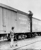 0526460 © Granger - Historical Picture ArchiveHOBOS, c1915.   A hobo climbing on top of a railroad car. Photograph, c1915.