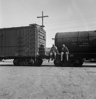 0526463 © Granger - Historical Picture ArchiveRAILROAD, 1937.   Itinerant men riding outside a train hauling oil tanks in Kingsbury, California.  Photograph by Dorothea Lange, 1938.