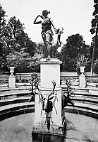 0092982 © Granger - Historical Picture ArchiveFRANCE: FONTAINEBLEAU.   Statue of the goddess Diana (Artemis) with a doe, on the grounds of the Chateau de Fontainebleau, France. Photographed mid-20th century.