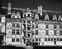0117678 © Granger - Historical Picture ArchiveFRANCE: CHATEAU DE BLOIS.   A view from the courtyard of the Château de Blois in the Loire Valley, France, showing the wing added by King Francis I, c1520, with its exterior spiral staircase. Photograph, mid-20th century.