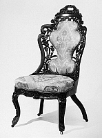 0116657 © Granger - Historical Picture ArchiveVICTORIAN CHAIR, c1850.   American carved rosewood side chair in the Victorian Rococo style, by John Henry Belter, New York, c1850.