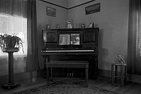 0121947 © Granger - Historical Picture ArchiveLIVING ROOM, 1936.   The corner of a farmhouse living room, near Dickens, Iowa. Photograph by Russell Lee, December 1936.