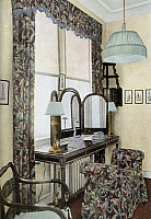 0118034 © Granger - Historical Picture ArchiveDRESSING ROOM, c1913.   A dressing room in an American home decorated with furniture and curtains in black chintz. Photographed for 'The House in Good Taste,' by interior decorator Elsie De Wolfe, published in 1913.