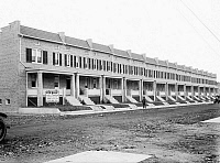 0119438 © Granger - Historical Picture ArchiveWASHINGTON D.C.: HOUSES.  A view of new row houses for sale on 14th and Taylor Streets in Washington D.C. Photograph, c1918-1921.
