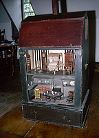 0127556 © Granger - Historical Picture ArchiveCOLONIAL DOLLHOUSE, 1744.   Painted pine dollhouse manufactured for the Homans family of Boston, Massachusetts, 1744.