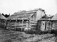 0124572 © Granger - Historical Picture ArchiveALASKA: LOG CABIN, c1899.   Log cabins in Kodiak, Alaska. Photograph by Edward Curtis, c1899.