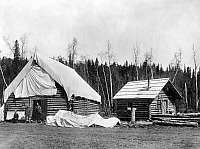 0124574 © Granger - Historical Picture ArchiveALASKA: LOG CABINS, c1920.   Homesteader cabins in Ship Creek, Alaska. Photograph, c1920.