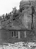 0124578 © Granger - Historical Picture ArchiveARIZONA: LOG CABIN, c1908.   Log cabin with a thatched roof in front of a large rock formation in Arizona. Photograph by Edward Curtis, c1908.
