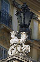 0355940 © Granger - Historical Picture ArchiveART & ARCHITECTURE.   Streetlight with putto and cornucopia, courtyard, Eszterhaza Palace (1720-1766), Fertod, Gyor-Sopron, Hungary. Full Credit: De Agostini / S. Vannini / Granger, NYC -- All Rights Reserved.