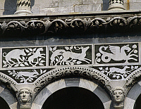 0359795 © Granger - Historical Picture ArchiveART & ARCHITECTURE.   Zoomorphic figures, decoration on the facade of the Church of St Michael, Foro (XI-14th century), Lucca, Tuscany, Italy. Full Credit: De Agostini / G. Berengo Gardin / Granger, NYC -- All rights reserved.