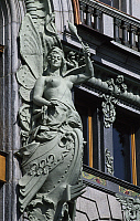 0360064 © Granger - Historical Picture ArchiveART & ARCHITECTURE.   Allegorical statue on the facade of the building which previously housed the Singer Sewing machine factory and former House of Books (Dom Knigi) (1902-1904) by the architect Count Pavel Syuzor, on Nevsky Prospect (Nevsky Avenue)(Nevsky Prospekt), Historic Centre of St Petersburg and Related Groups of Monuments (Unesco World Heritage Lis