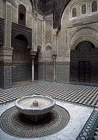 0361248 © Granger - Historical Picture ArchiveART & ARCHITECTURE.   Courtyard with fountain, Al-Attarine Madrasa (14th century), Fez el Bali (Unesco World Heritage List, 1981), Fes-Boulemane, Morocco. Full Credit: De Agostini / C. Sappa / Granger, NYC -- All rights reserved.