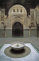 0361258 © Granger - Historical Picture ArchiveART & ARCHITECTURE.   Courtyard with fountain, Al-Attarine Madrasa (14th century), Fez el Bali (Unesco World Heritage List, 1981), Fes-Boulemane, Morocco. Full Credit: De Agostini / C. Sappa / Granger, NYC -- All rights reserved.
