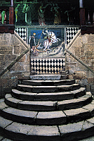 0362427 © Granger - Historical Picture ArchiveART & ARCHITECTURE.   Circular staircase and fresco of St George slaying the dragon (1415), courtyard of Fenis Castle (13th-18th century), Valle d'Aosta, Italy. Full Credit: De Agostini / S. Vannini / Granger, NYC -- All rights reserved.