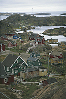 0420356 © Granger - Historical Picture ArchiveART & ARCHITECTURE.   High angle view of dwellings on fjords, Sisimiut, Greenland Full credit: De Agostini / D. Staquet / Granger, NYC -- All Rights Reserved.