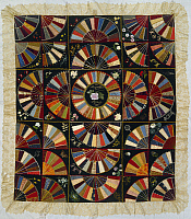 0129002 © Granger - Historical Picture ArchiveMAINE: QUILT. 1886.   Patchwork quilt from Maine, embroidered and painted.