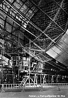 0090856 © Granger - Historical Picture ArchiveZEPPELIN CONSTRUCTION.   Attaching the passenger and steering gondola to the frame of the Graf Zeppelin LZ 127 airship at the Zeppelin Aircraft Works in Friedrichshafen, Germany. Photo postcard, c1930.
