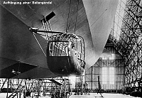 0090859 © Granger - Historical Picture ArchiveZEPPELIN CONSTRUCTION.   Attaching one of the side gondolas to the Graf Zeppelin LZ 127 airship at the Zeppelin Aircraft Works in Friedrichshafen, Germany. Early 20th century postcard.